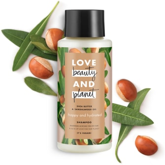 Framsida av schampoförpackning Love Beauty Planet Kokosvatten & Mimosa schampo Volume & Bounty 400 ml